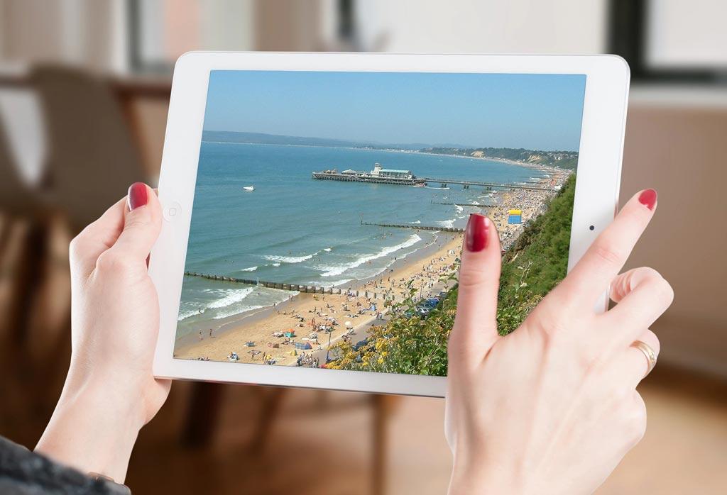 website designer in Bournemouth holding a tablet